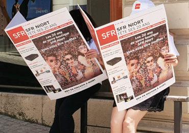Journaux Géants devant SFR