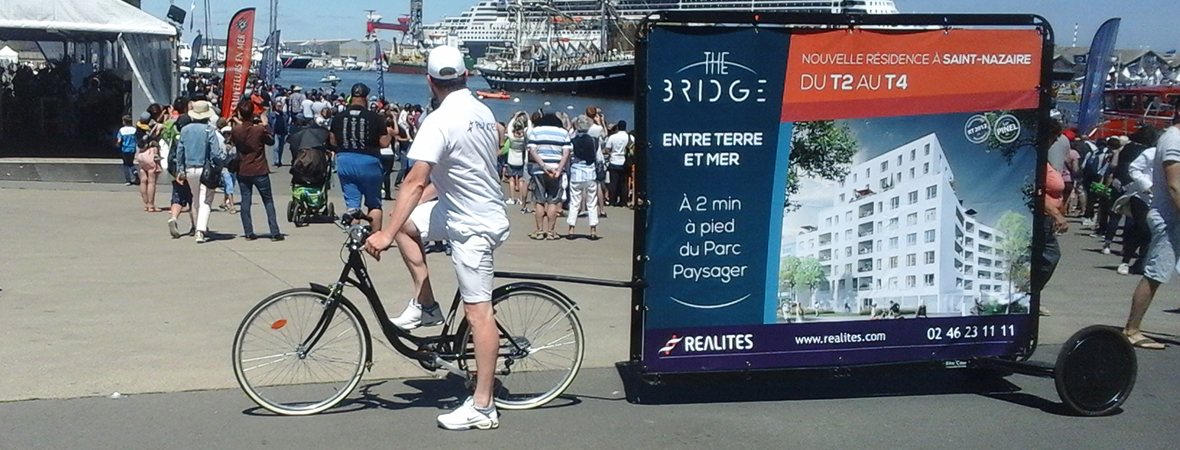 Promoteur Realites - street marketing en Bike'Com - NON STOP MEDIA Atlantique