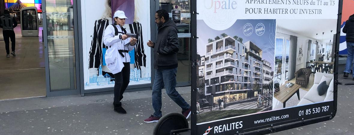vélo publicitaire Bike'Com pour Opale du Groupe Réalités