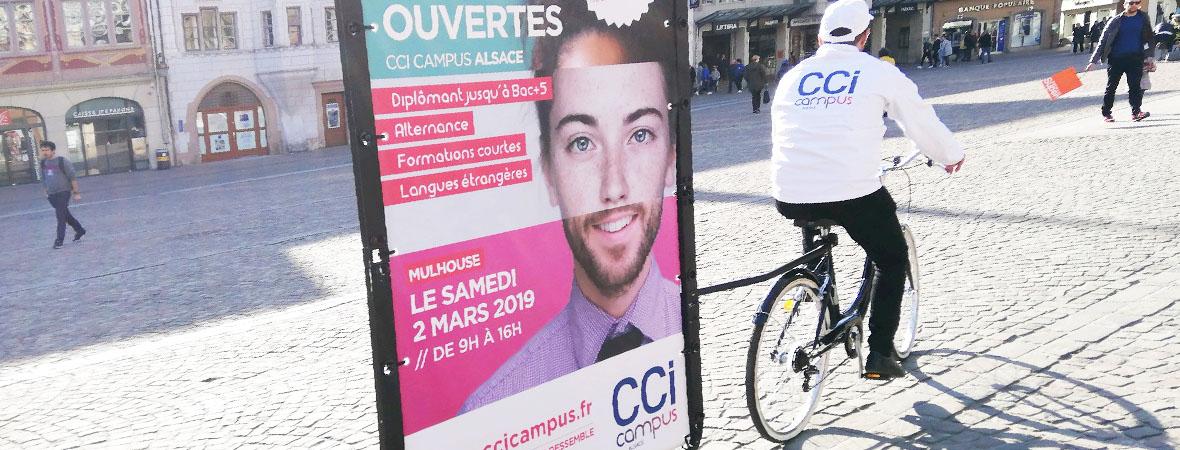 Distribution de flyers et vélo publicitaire pour la CCI Campus avec NON STOP MEDIA Grand Est